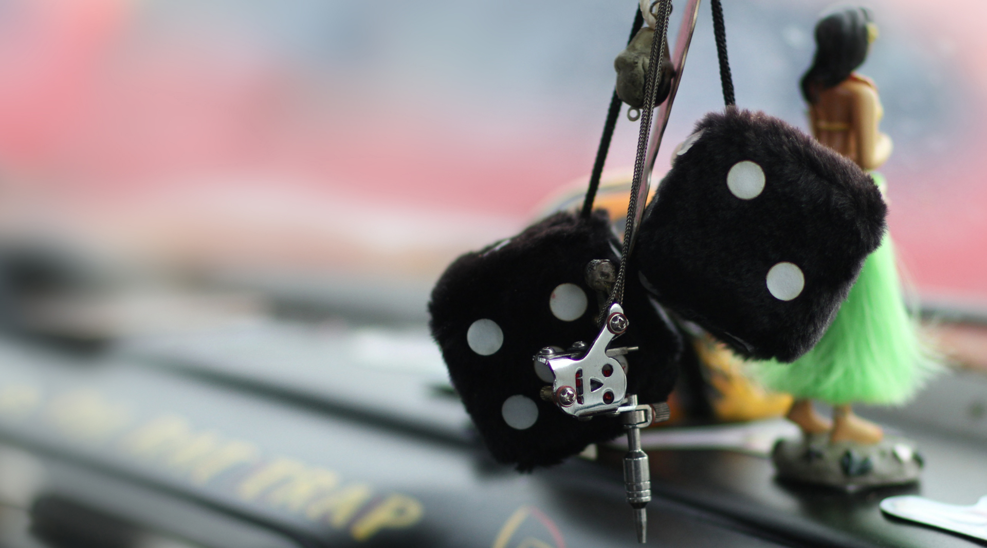 Dice hanging from the mirror as traffic violation